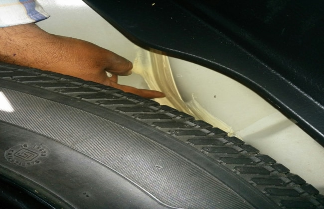 Check pasting under the spare wheel